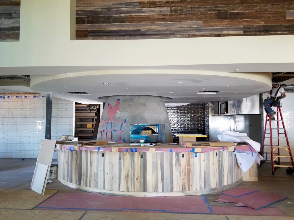 A counter under-construction with an oven behind it.