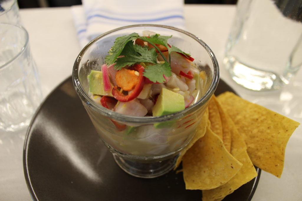 Colorado striped bass ceviche with avocado, cilantro, fresno chiles with warm tortilla chips