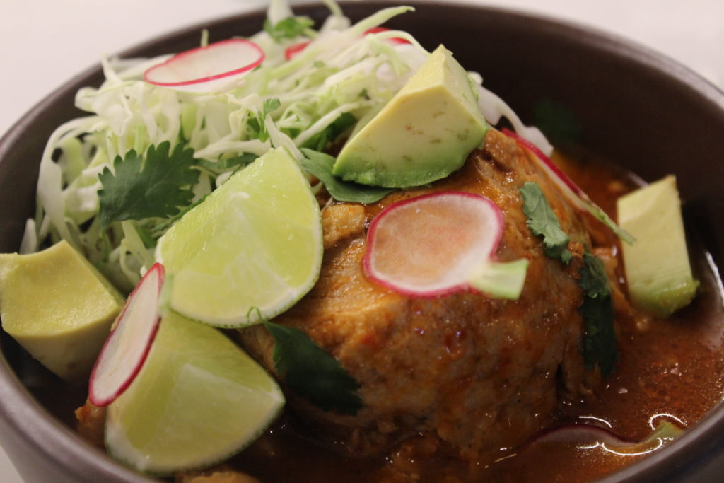 Braised Heritage pork with guajillo, hominy and posole garnish