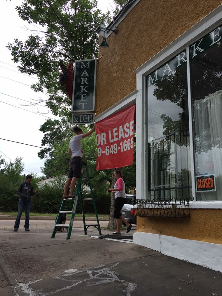 Taking down the for-lease sign.